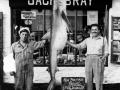 1955-07-21-180-lbs-Blue-shark-record-caught-by-H-J-Whiddett-on-Paula-skipper-Jack-Butters